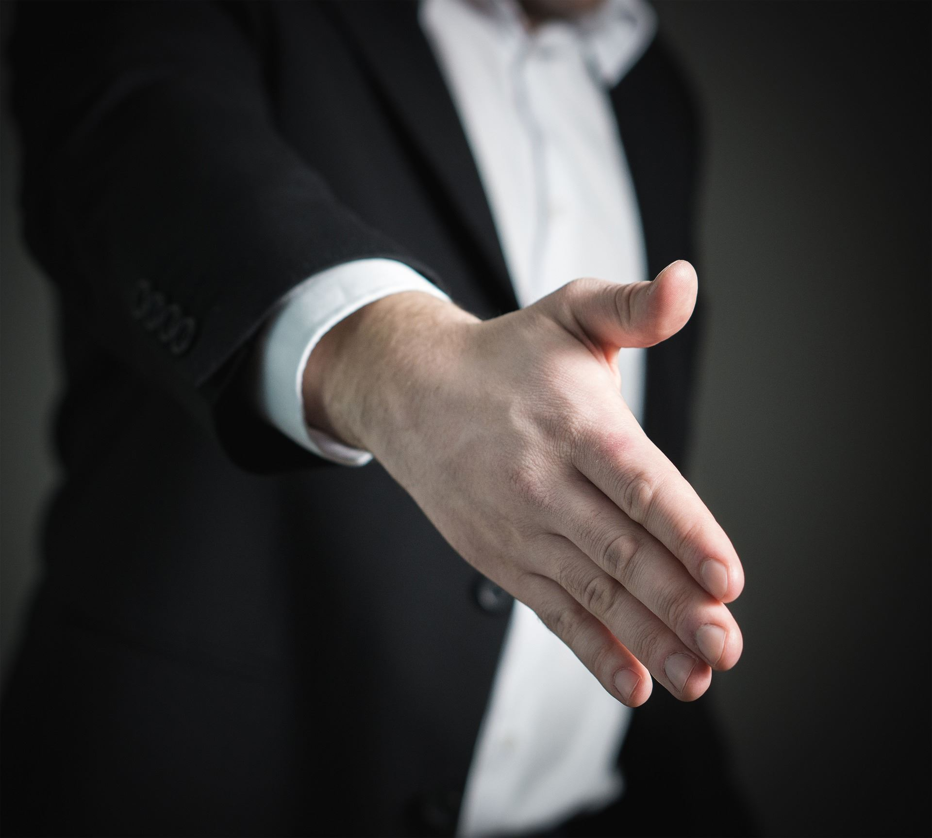 A hand extended out for a handshake